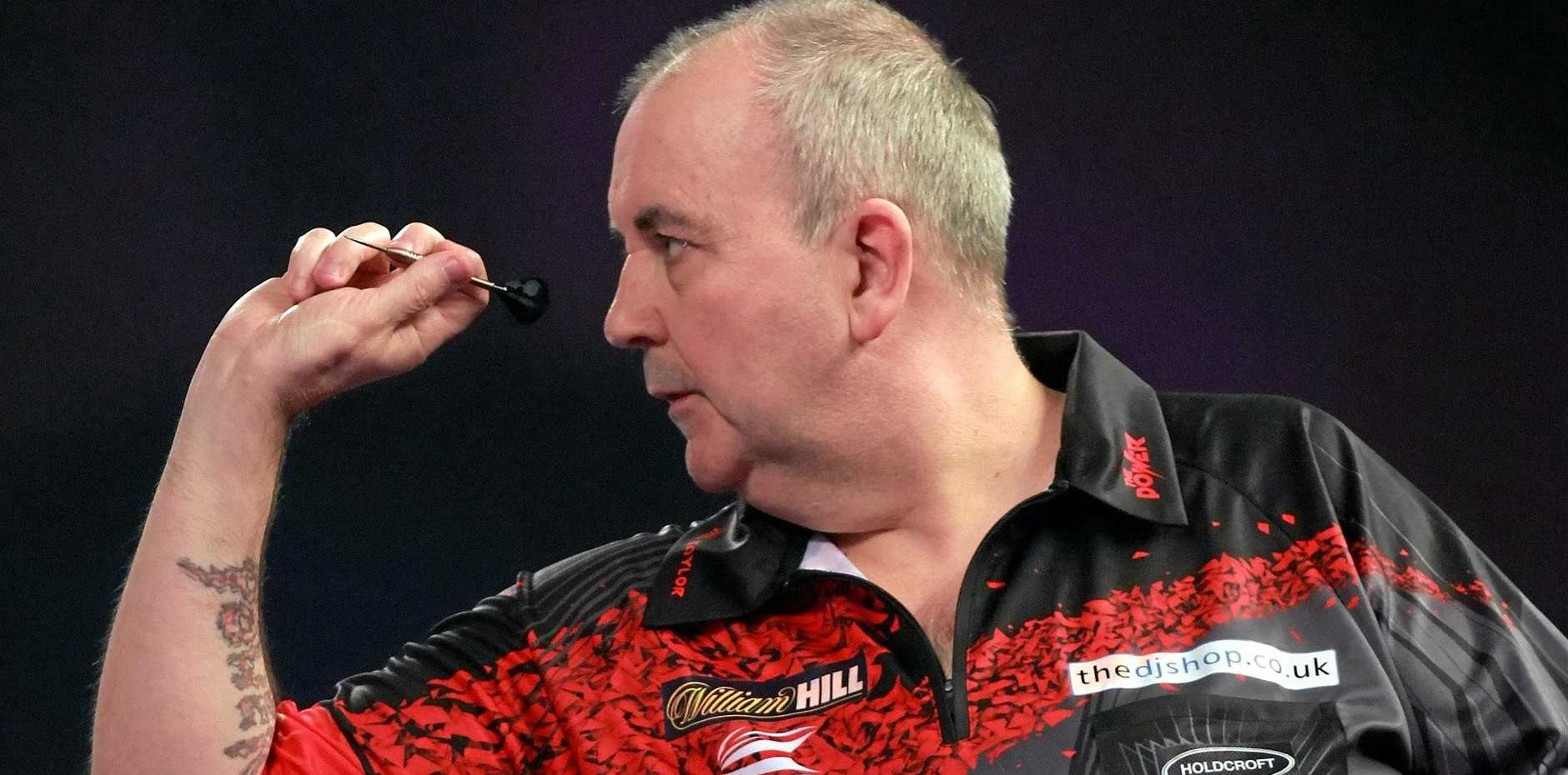 Phil Taylor takes aim at the World Darts Championship in London.