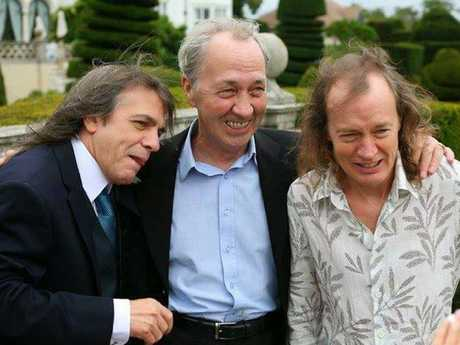 George Young (centre) with his brothers  Malcolm Young  and  Angus Young.