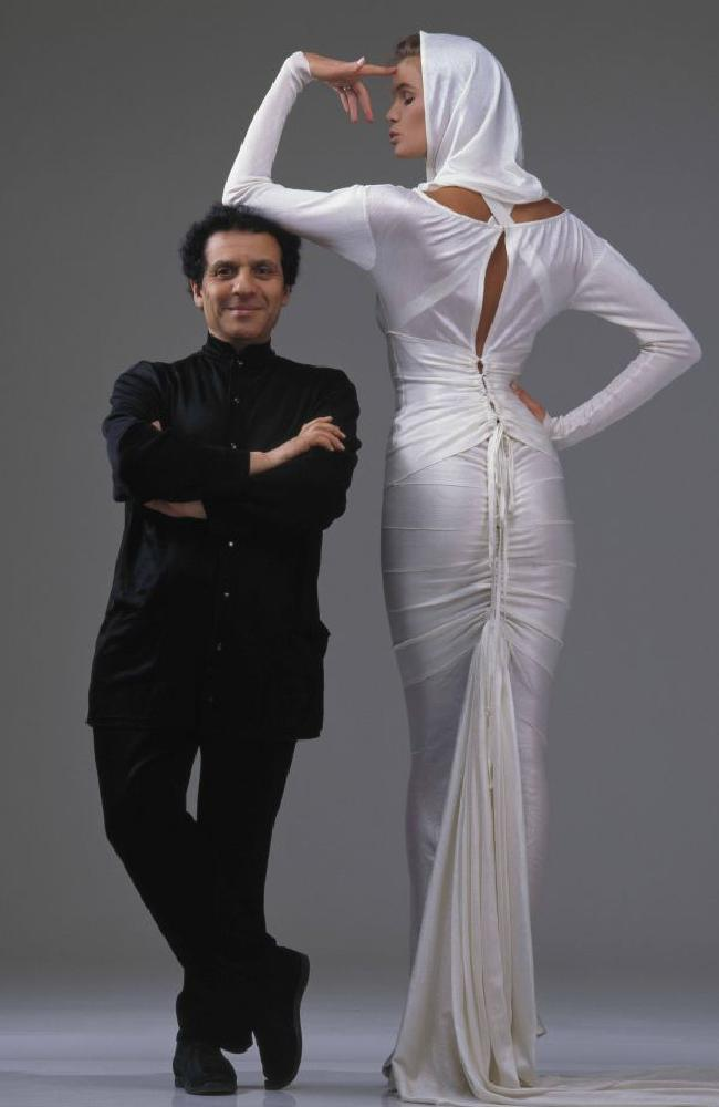 Azzedine Alaia with Elle Macpherson, who is wearing the wedding dress he designed for her when  she married Gilles Bensimon  in 1986.