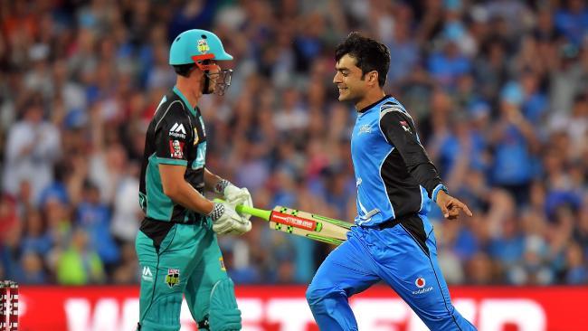 Rashid Khan celebrates after dismissing Heat batsman Chris Lynn.