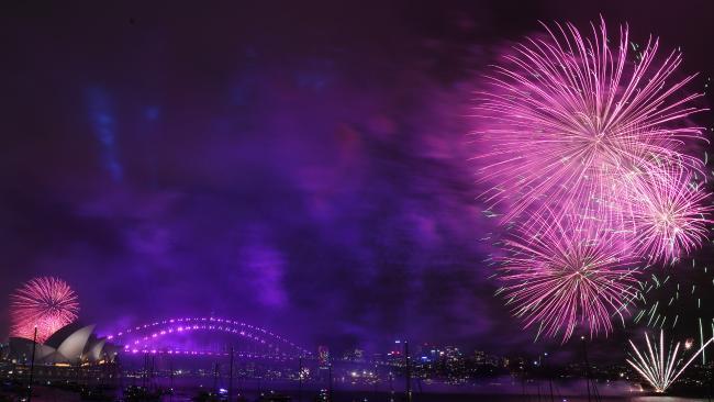 Fireworks explode over Sydney Harbour at 9pm during NYE celebrations.