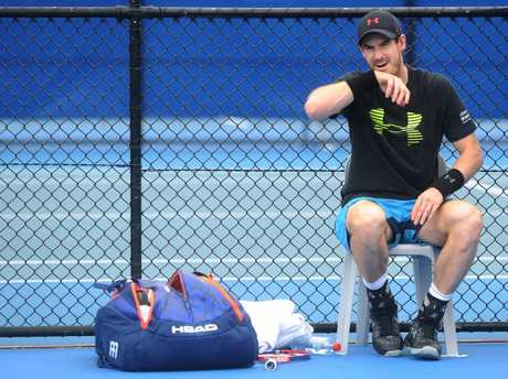 Andy Murray takes a break during training.