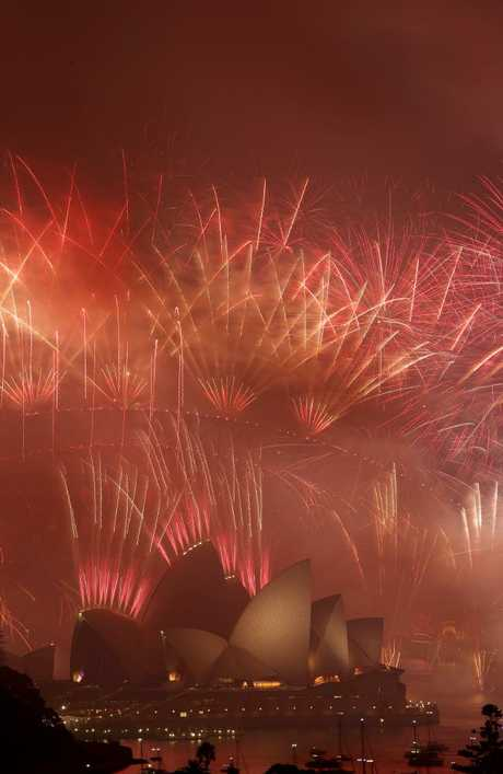 New Year's Eve midnight fireworks over Sydney Harbour. Picture: Jonathan Ng
