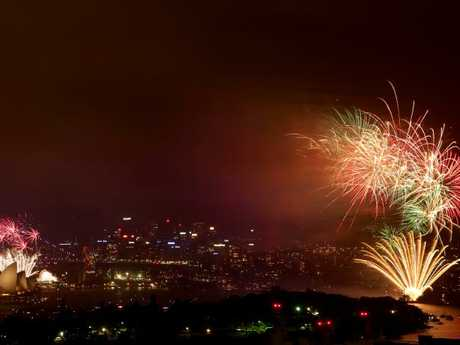 New Year's Eve 9pm fireworks over Sydney Harbour  from Potts Point. Picture: Jonathan Ng