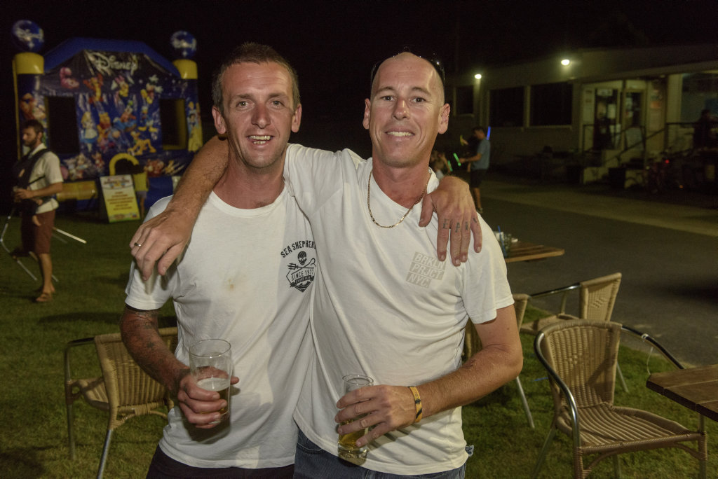 Image for sale: Jarad Madden and Todd Clifton enjoy a beer and a good time at the Yamba Golf Club.
