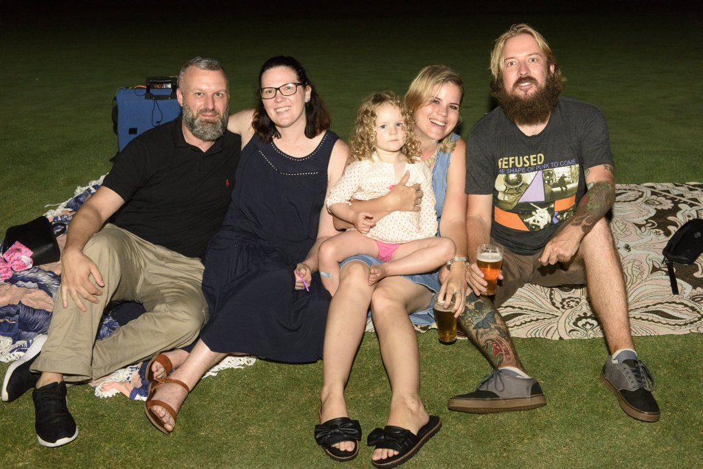 Image for sale: Max Renee and Amali Taverna, Tegan Willits and Dane Byrne grabbed a spot on the grass for New Years Eve at the Yamba Golf Club.