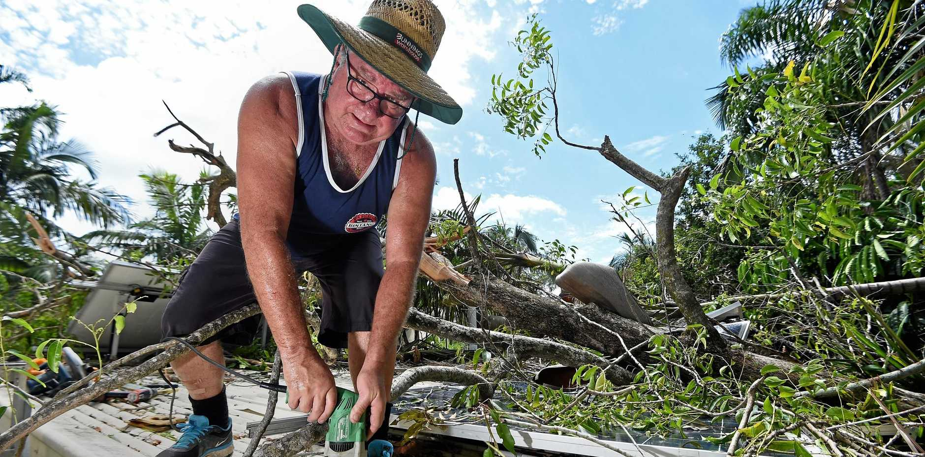 STUART Dell repairs damage to his house on Wren Crescent, Buderim, after a tornado-like storm ripped up Buderim-Mooloolaba Road bringing down branches and trees.