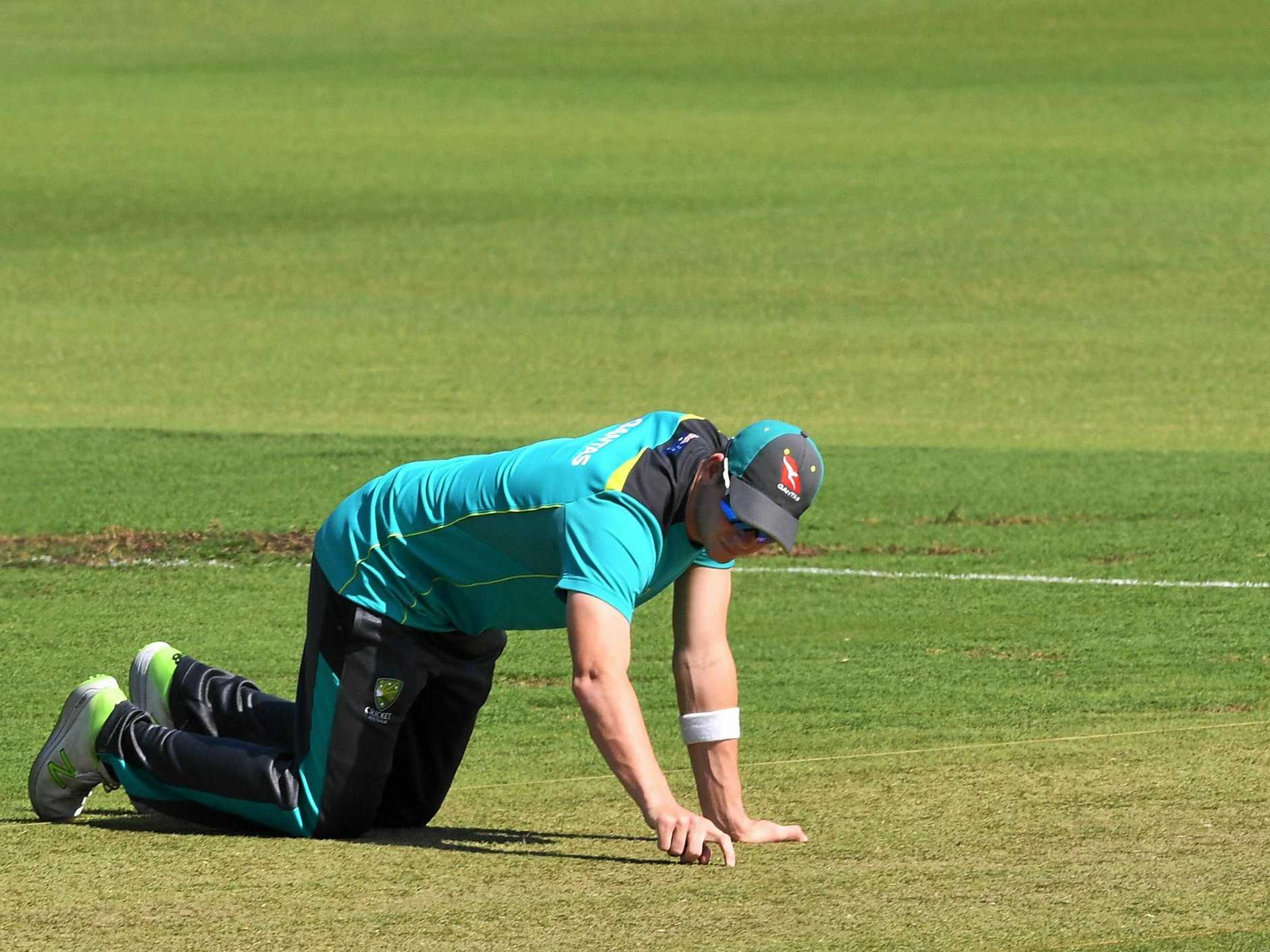 Australian captain Steve Smith inspects the WACA wicket ahead of the third Ashes Test.