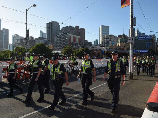 Police patrol in Melbourne ahead of the New Year's Eve fireworks. Picture: Mal Fairclough