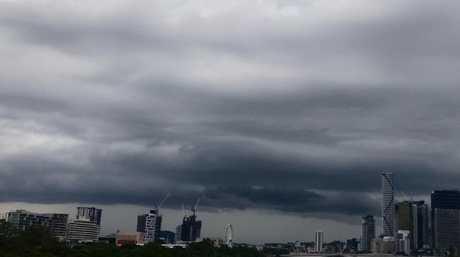 Storm clouds gather over the Brisbane River. Picture: AAP/Steve Pohlner
