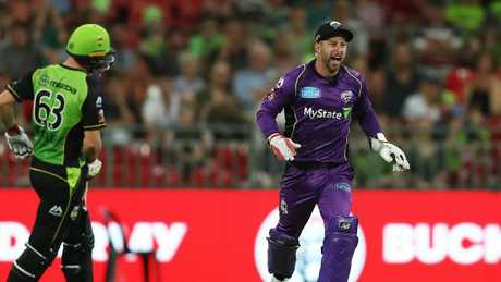 Hobart Hurricanes Matthew Wade celebrates after running out Sydney Thunder's Jos Buttler. Picture: Brett Costello