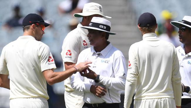 James Anderson (left) and Stuart Broad of England (second from left) and Joe Root of England speak with the match umpires on day four of the Boxing Day Test.