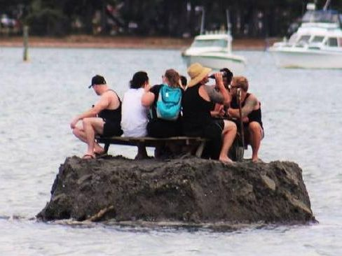 Revelers build island to skirt public drinking ban on New Year's Eve