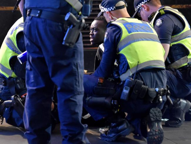 Victorian Police apprehend a man in Flinders St, Melbourne on New Year's Eve. Picture: Jay Town