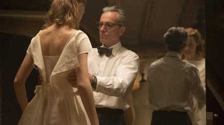 Vicky Krieps, left, and Daniel Day-Lewis appear in a scene from