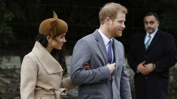 Prince Harry and his fiance Meghan Markle walk following the traditional Christmas Day church service, at St. Mary Magdalene Church in Sandringham, England