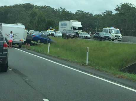 Two trucks and a car have crashed on the Bruce Highway,