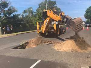 WATCH: Growing sinkhole forces road closure