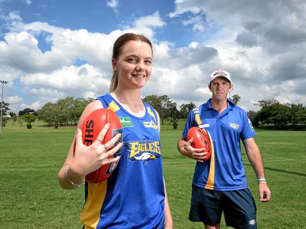 BIG YEAR AHEAD: Taylor Mansell with father and Ipswich Eagles Aussie rules coach, Kym Mansell. The pair are excited about the Eagles fielding a women's team in 2018.