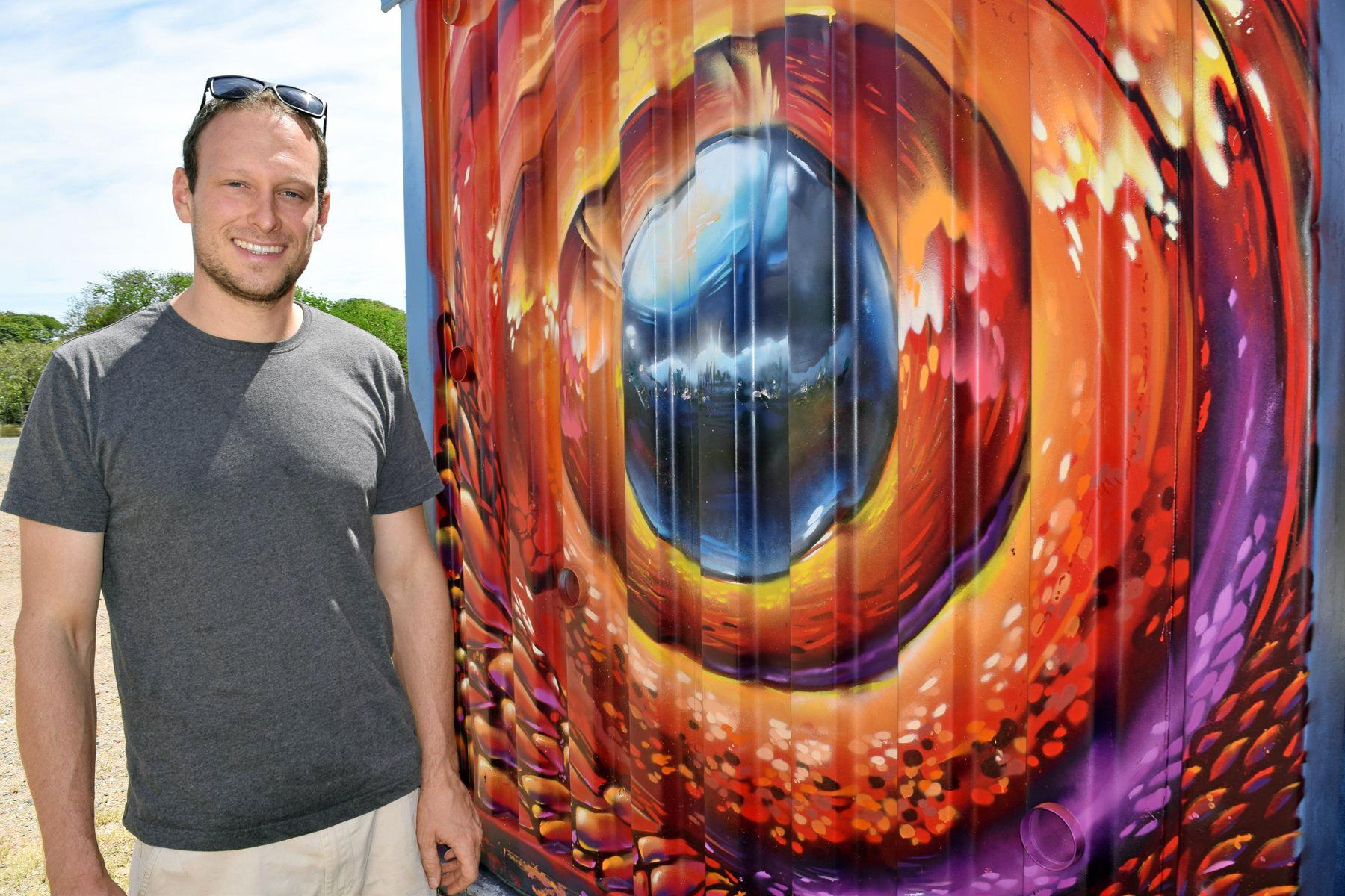 Yeppoon artist Martin Schlick with his work at the Keppel Coast Arts containers next to the Information Centre.