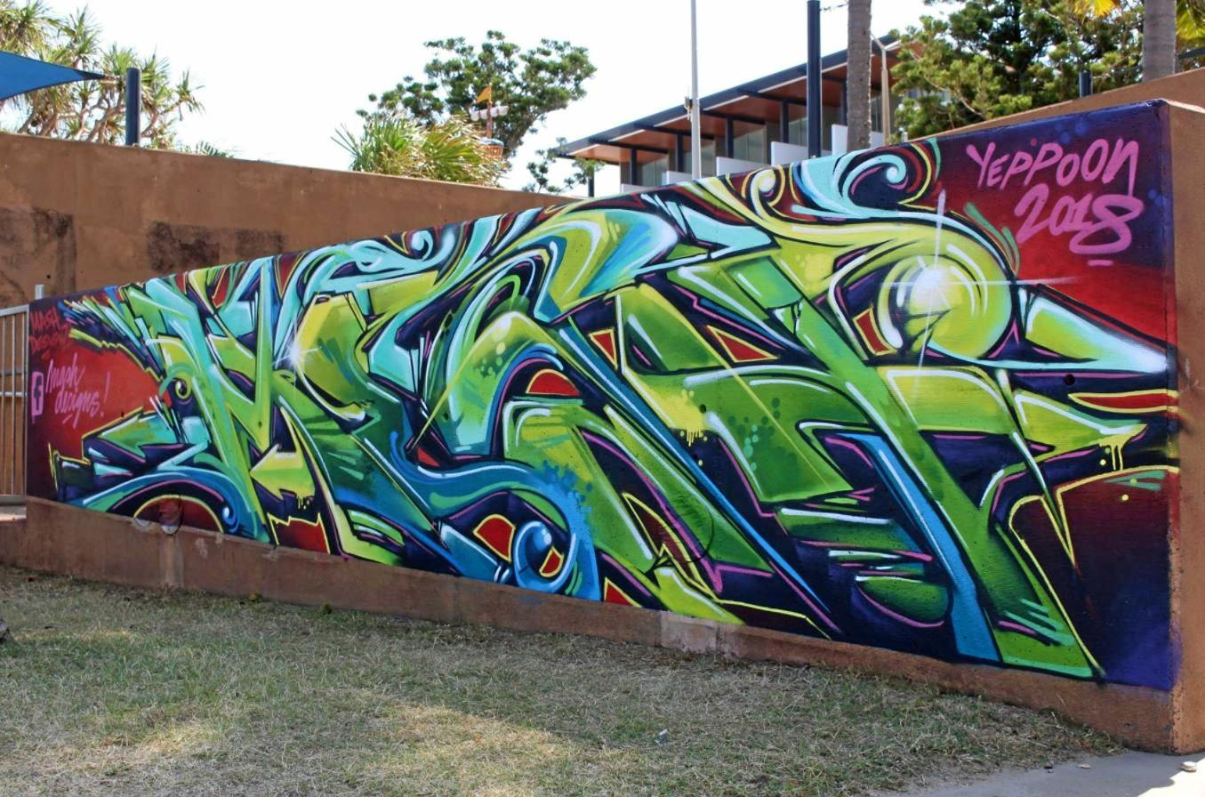 The newest artwork from Martin Schlikc (inset) from Mash Designs n the Yeppoon Man Beach has gotten mixed reviews from the community.