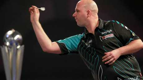 Rob Cross in action during World Darts Championship final.
