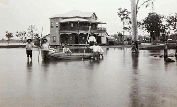 People swimming in the flood waters outside the former Balmoral pub in the 1890 Rockhampton flood.