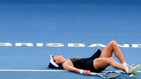 Garbine Muguruza struggled through her clash with severe cramping in Brisbane