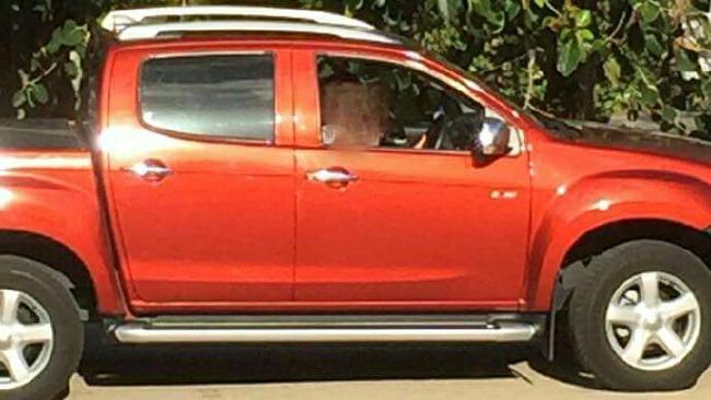 The orange 2014 Isuzu D-Max Dual Cab left almost unusable by the thieves.