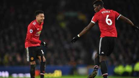 Manchester United's English midfielder Jesse Lingard (L) celebrates scoring the team's second goal with Manchester United's French midfielder Paul Pogba