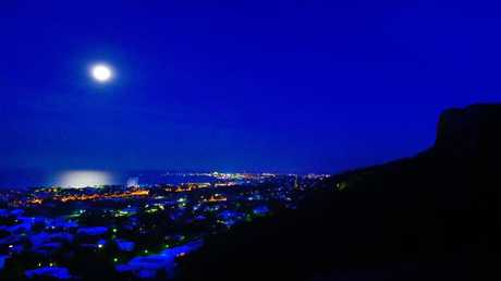 "The full moon rises over Townsville on Monday night. A blue moon is the second full moon in a single month and takes place rarely, leading to the expression ""once in a blue moon""."