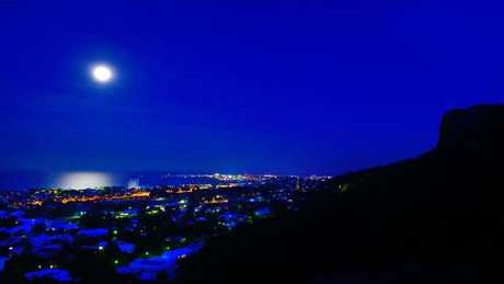 """The full moon rises over Townsville on Monday night. A blue moon is the second full moon in a single month and takes place rarely, leading to the expression """"once in a blue moon""""."""