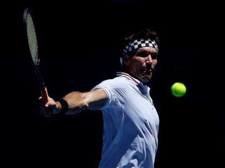Tennis legend Pat Cash fills in for Jack Sock in the mixed doubles match against Japan.