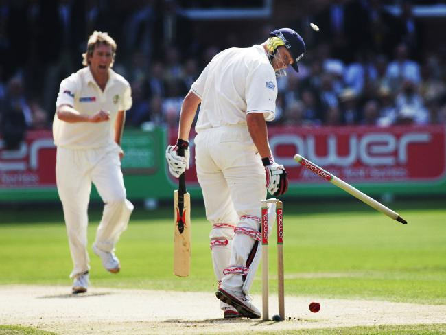 Glenn McGrath knocks over Andrew Flintoff's castle. Picture: Phil Hillyard.