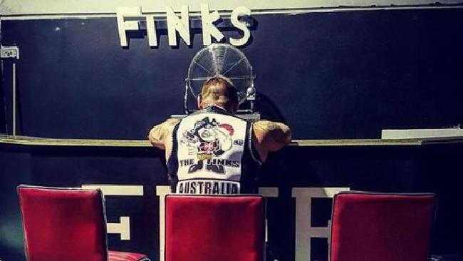 A member sits in a Finks clubhouse