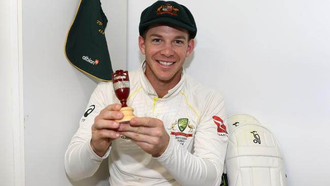 Tim Paine celebrates in the changerooms after Australia regained the Ashes.