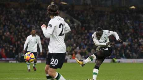 Sadio Mane of Liverpool scores
