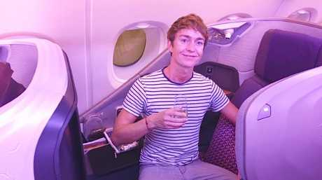 Getting cosy in business class.