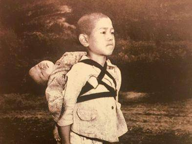 A boy carries his dead brother on his shoulders while he waits at a cemetery in Nagasaki in an image taken by US Marine Joe O'Donnell in 1945. Source: Vatican Press Office