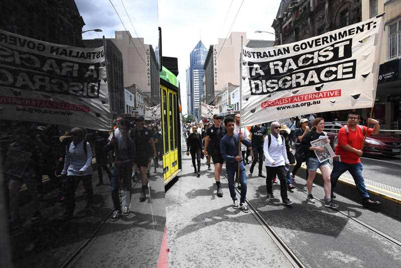 Protesters are seen during a nation wide demonstration to protest the Australian government's treatment of refugees on Manus Island, Melbourne