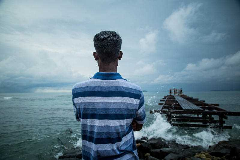 Image obtained Tuesday, November 28, 2017 of asylum seeker Dennis, 36, from Sri Lanka looking out to the sea on Manus Island