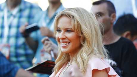 Australian singer Kylie Minogue arrives to the world premiere of Swinging Safari at Hoyts Cinemas Entertainment Quarter in Sydney, Tuesday, December 12, 2017.
