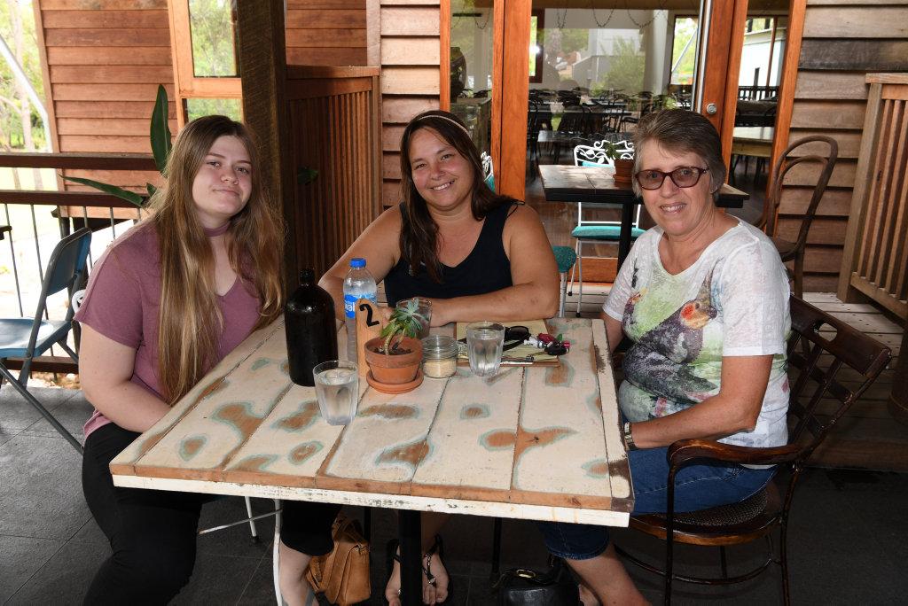 Image for sale: HOLIDAY SOCIALS: Kristal Duncan, Julie Bauer and Margaret Gibbs at Eleven Acres in Branyan.