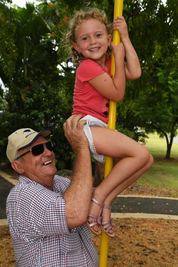 Image for sale: HOLIDAY SOCIALS: Derick Shaw helps Ada Shaw climb the fireman's pole at Alexandra Park.