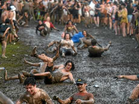 WET: The rain turns the valley into a mud bath on the second day of Falls Festival at Byron Bay.