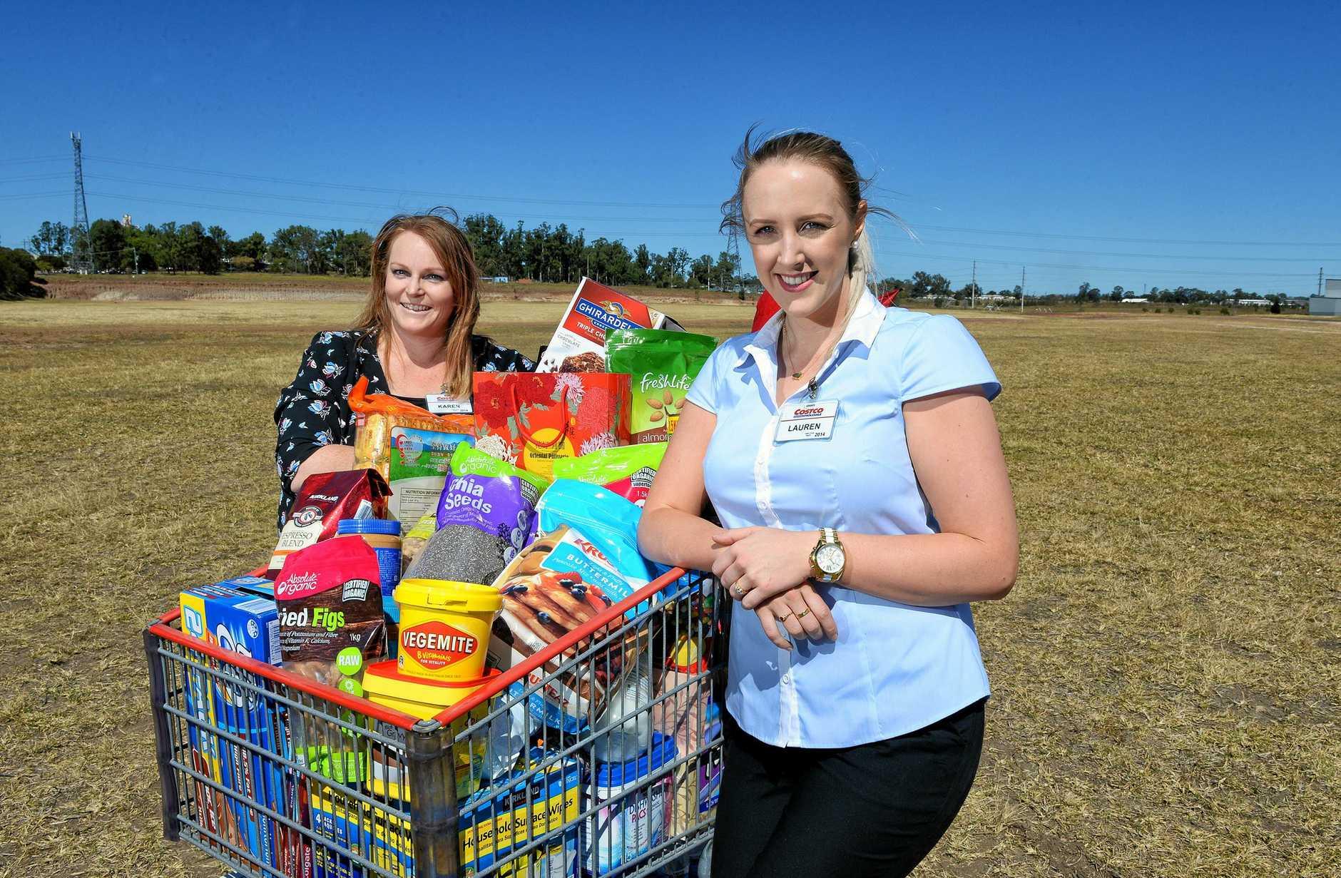 Costco employees Karen and Lauren prepare for the Bundamba store opening this year.