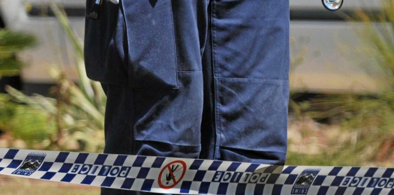 Crime scene investigator with Police tapePhoto: Brett Wortman / Sunshine Coast Daily
