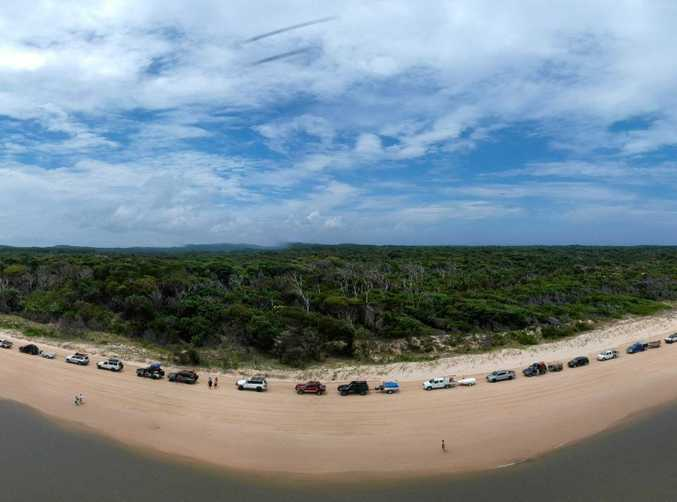 MASSIVE: The line-up on Fraser Island for vehicles wanting to return to Inskip Point at about midday on Tuesday.