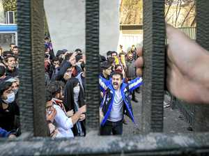 As protests build, Iran's leader blames US, other countries