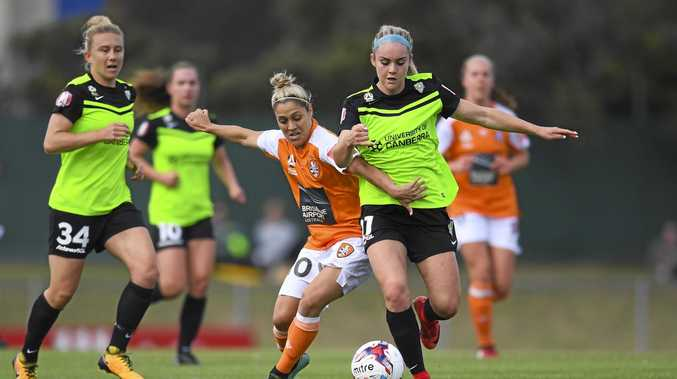 Ellie Carpenter (right) in action for Canberra United.